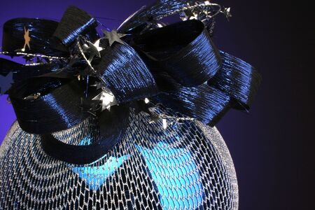 blue ordainment with ribbons and stars