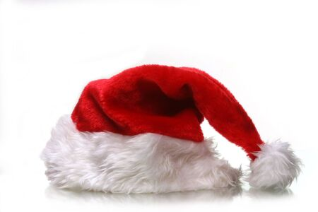 saint nicks furry red holiday hat on white with plenty of copy space
