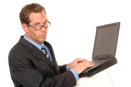 businessman typing on his computer laptop on white backdrop Imagens