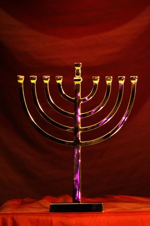 traditional Hanukkah menorah on red background photo