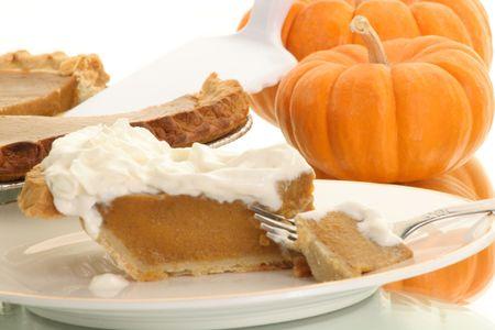 piece of pumpkin pie ready to be eaten photo