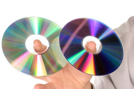 hand holding two cds on white photo