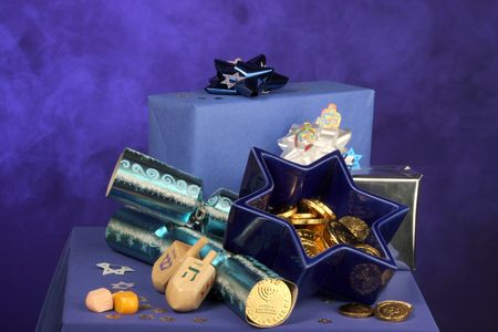 lots of Hanukkah decorations gelt, star of David, packages and dreidels photo