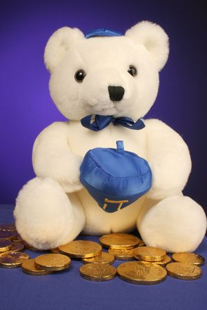 white teddy bear with dreidel ready for Hanukkah