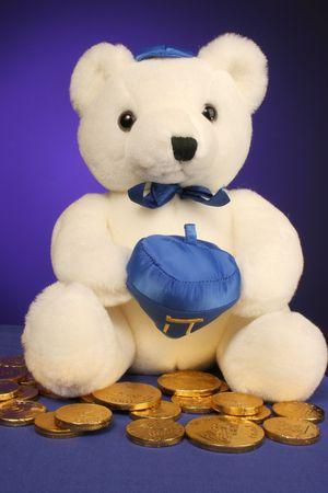 dreidel: white teddy bear with dreidel ready for Hanukkah