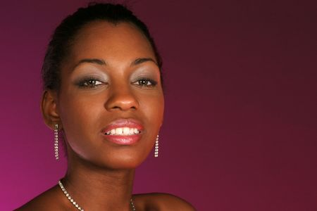 lifting her head this beautiful ladys headshot on purple background in horizontal format