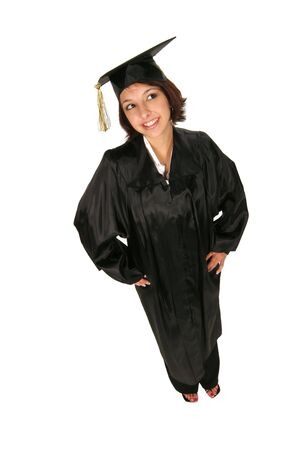 graduate in cap and gown standing on white background Stock Photo