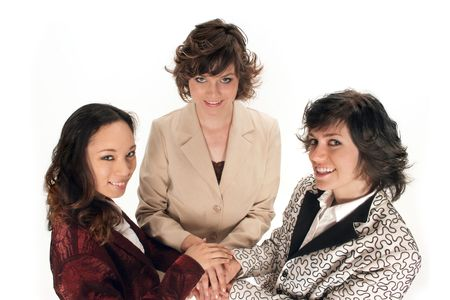 altogether: three women all in hands on top of each other