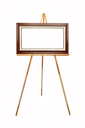 empty picture frame waiting for your art work on wooden easel Stock Photo