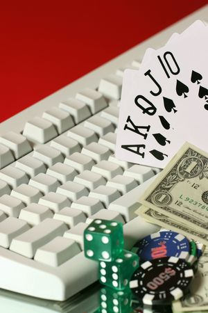 creditcards: chips, dice, money, card are all on line gaming Stock Photo