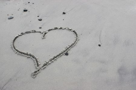 horizontal of heart drawn in the sand photo
