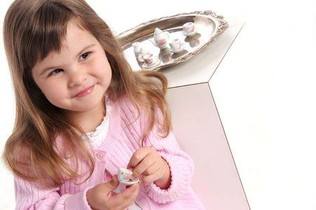 satisfying: satisfying smile after enjoying her tea