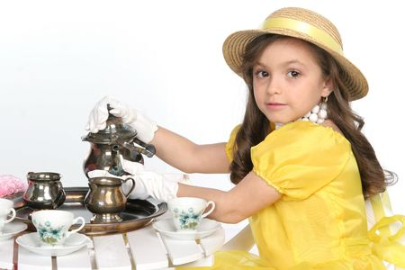 young lady dress for tea in brite yellow with hat Imagens