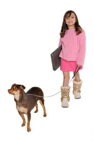 isolated on white young girl takes dog for a walk carrying her laptop Imagens