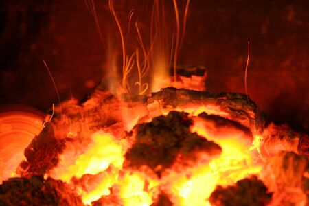 ignited: red hot sparks fly up from the fire Stock Photo