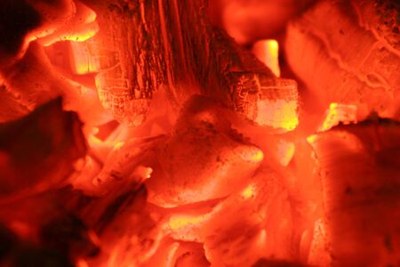 ignited: close up of glowing hot embers in the middle of a fire