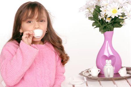 young girl enjoys tea tasting