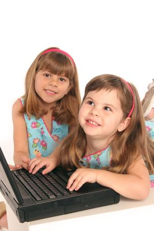 showing her sister something on her computer laptop
