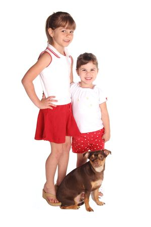 isolated on white these two young girls with their dog full view