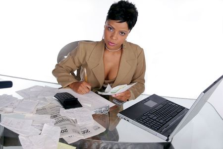 young woman sits down to begin figuring out her taxes Imagens
