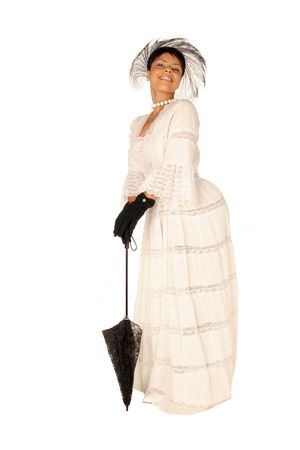 female in lace dress, gloves, hat and standing with a black umbrella in full view Stock Photo - 352233