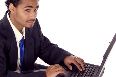 young man on his laptop looking at you Stock Photo