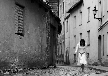 barefoot women: lonely angel walking on the streets of Old City Stock Photo