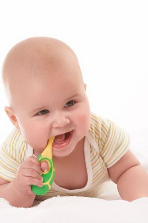 kiddie: baby with toothbrush cleaning first tooth