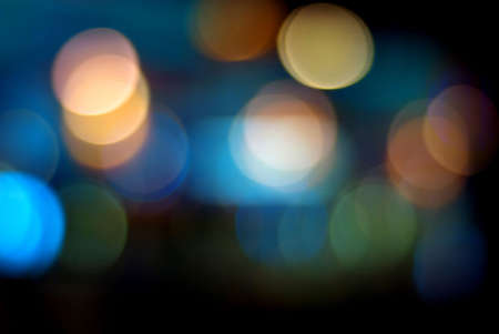 blur effect: Colourful defocused lights on dark background Stock Photo