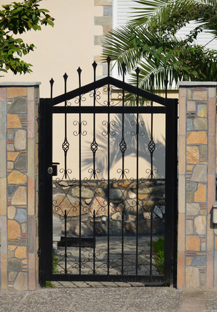 modern metal gate. Modern Metal Gate For The Private House Stock Photo - 30808171