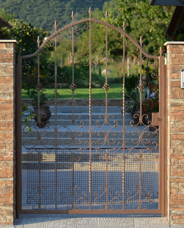 modern metal gate for the private house photo