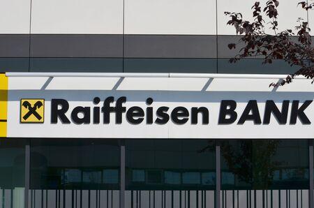 BELGRADE, SERBIA - JUN 9, 2019: Raiffeisen logo on bank in Belgrade, New Belgrade Publikacyjne