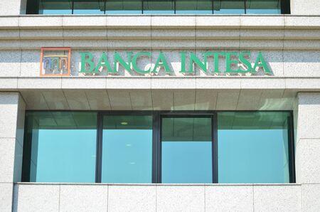 BELGRADE, SERBIA - JUN 9, 2019: Sign of Banca Intesa on wall  outdoor Publikacyjne