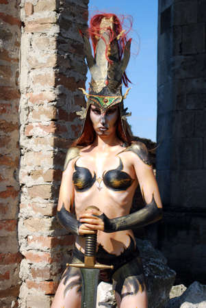 body paint sexy: barbarian girl with sword Stock Photo