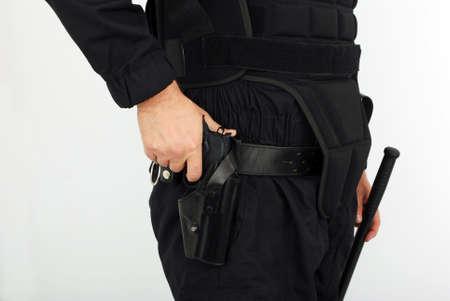 security vest: police equipment gun and nightstick Stock Photo