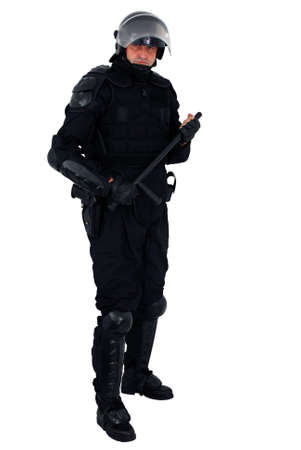 nightstick: riot policeman isolated