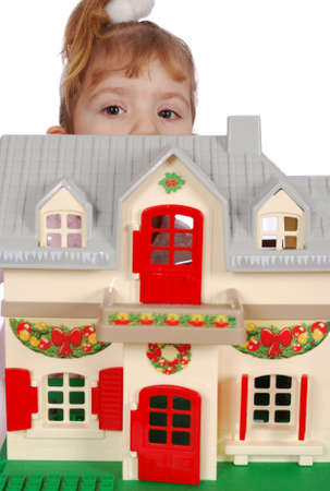 protruding eyes: little girl protruding behind toy house