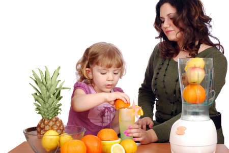 little and adult girl made fruit juice photo
