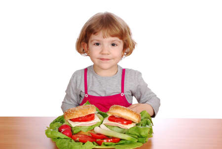 little girl with sandwiches and vegetables Stock Photo - 6857187