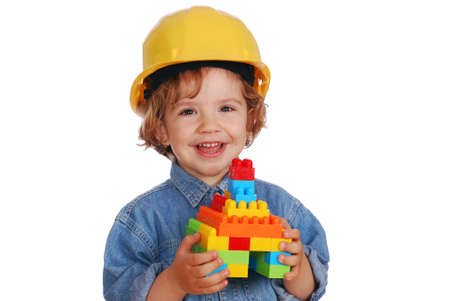 little girl builder with toy block house photo