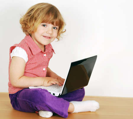 little girl with laptop photo