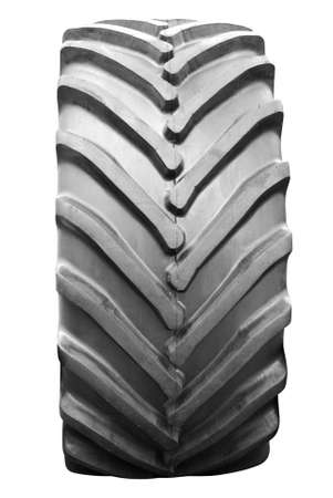 tread: big tractor tire isolated Stock Photo