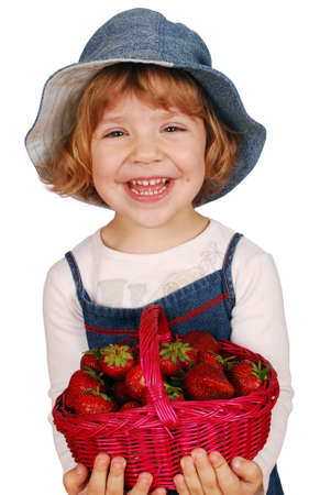 happy little girl with strawberries photo