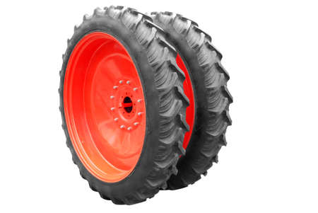 tractor big wheel isolated on white background photo