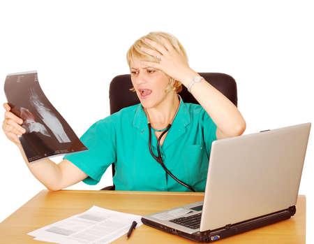 catastrophic: female doctor looking at catastrophic results Stock Photo