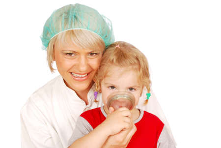 female doctor gives the child inhalation photo