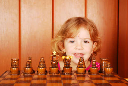 little girl and chess  photo