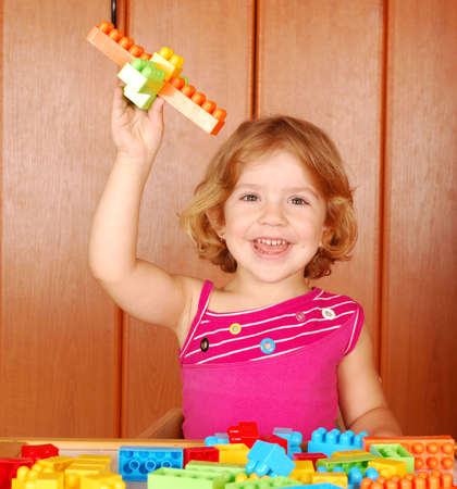 little girl fun with toy block photo