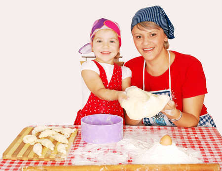 mother and daughter make croissants photo