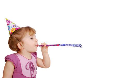 little girl with birthday hat and trumpet photo